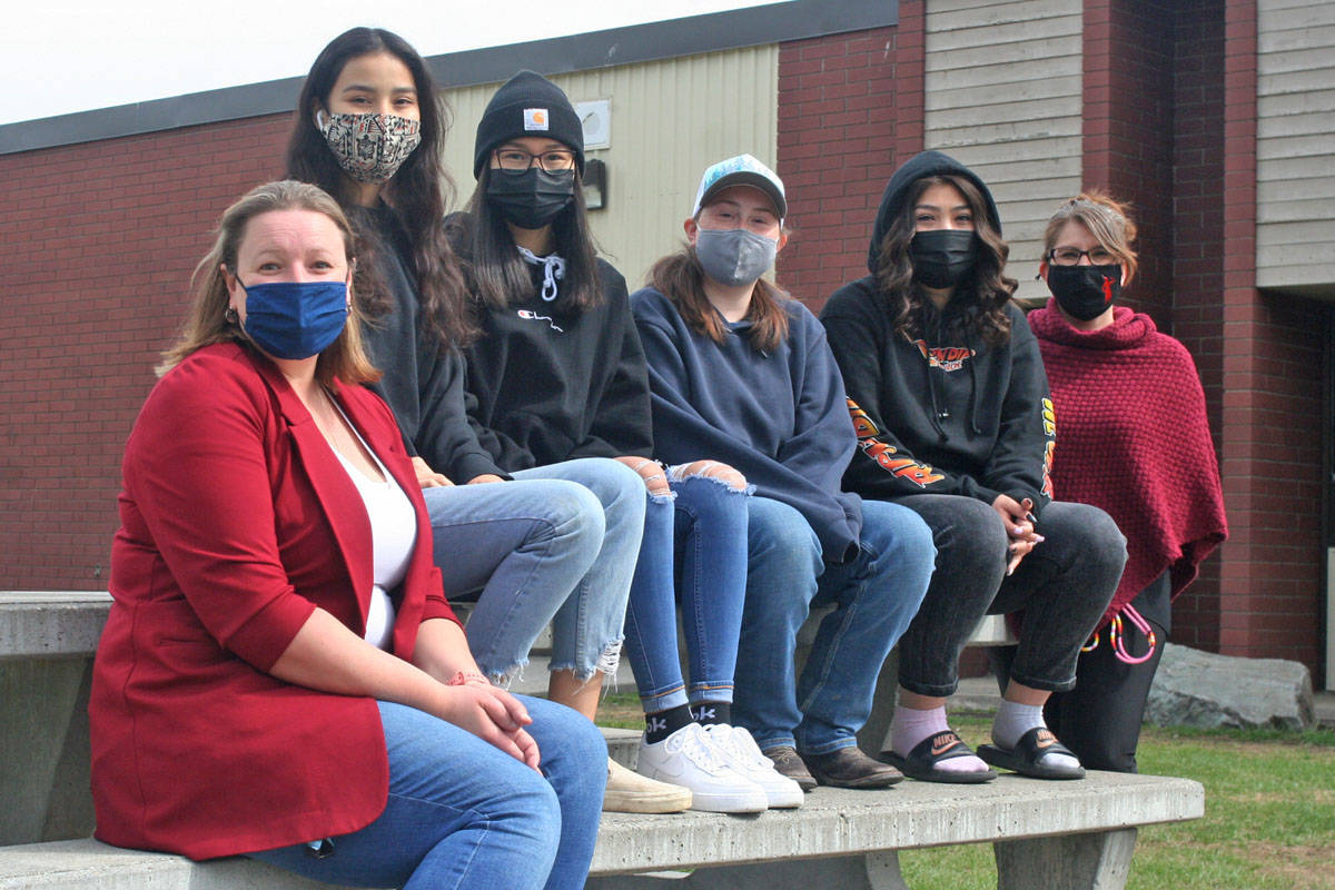 Correlieu Secondary School teacher Ashleigh Desbiens-Korum (far left) and Keri Osha (far right) stand alongside the students behind an awareness campaign for Missing and Murdered Indigenous Women at the school including: Joely Paul (from left), Adrianna Alec, Amber Martin and Jessica Johnny (Cassidy Dankochik photo - Quesnel Cariboo Observer)
